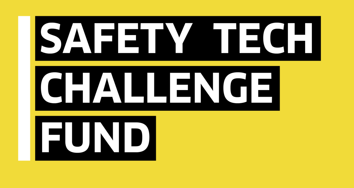 """White text saying """"safety tech challenge fund"""" on a yellow background"""