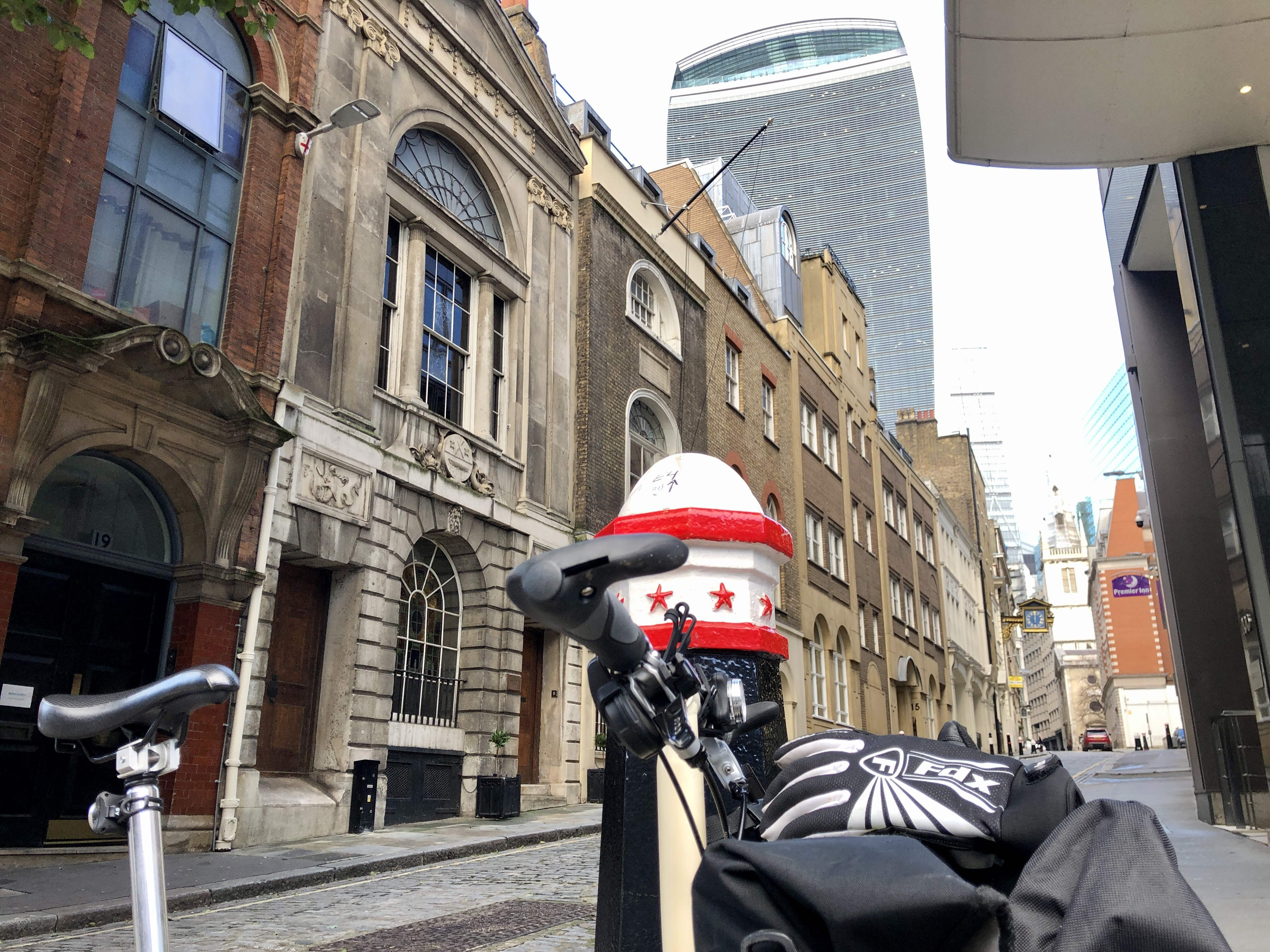 Brompton bike in front of The Walkie Talkie building in London